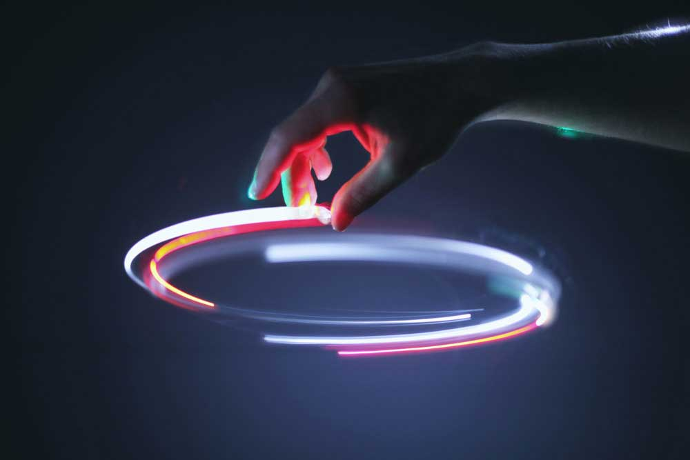 Hand making gestures with light.